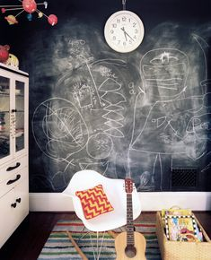 Kids' Room Photo - A white molded-plastic chair and a striped rug in a room with a chalkboard wall