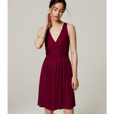 LOFT Petite Double V Flare Dress ($60) ❤ liked on Polyvore featuring dresses, purple potion, ruched jersey dress, loft dresses, flare dress, jersey wrap dress and purple wrap dress