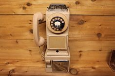 A great decorative pink vintage wall pay telephone made by Northwest Automatic Electric Company.