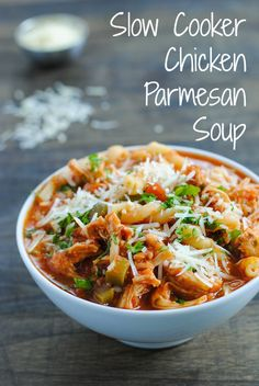 Slow Cooker Chicken Parmesan Soup - All of the flavors of decadent Chicken Parmesan in a waistline-friendly crockpot soup! Takes just minutes to prep.