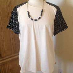 J.CREW Top with Tweed sleeves This great looking top is Blush/cream color with raglan black and white tweed sleeves. Shirttail hem is slightly longer in back. 100% Cotton and Sleeves are 44% Acrylic 28% Wool 19% Polyester 5% Viscose 4% Other Fiber J. Crew Tops
