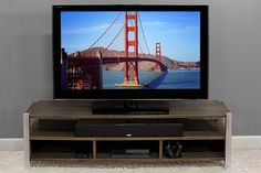 Create a great-looking home for your television with this stylish TV stand. It accommodates up to 60