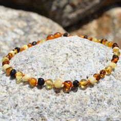 6893ccb20787aa Shop handmade amber jewelry to help babies with uncomfortable teething.  Baltic Amber is a fossilized resin that is produced by extinct coniferous  trees.