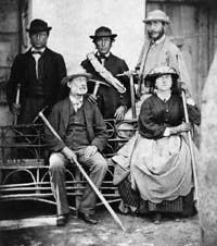 Lucy Walker, [1836 - 1961] first woman to climb the Matterhorn, Balmhorn, Wetterhorn, Lyskamm, and Piz Bernina. Lucy wore a white flannel dress, as  Victorian women did, to undertake her alpine adventures. Also in this photo, seated, is her father Frank Walker, [unknown perhaps Lucy's brother], Melchior Anderegg, and Adolphus Warburton Moore.jpg
