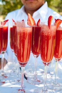 Strawberry Champagne Mimosas!! Ingredients: 4 oz. Champagne  2 oz. Orange Juice  2 oz. Strawberries  1/2 oz. Strawberry Syrup...Blend until smooth and pour into a cocktail glass. Add the Champaign and garnish with a whole strawberry.