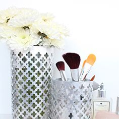 Create pretty aluminum containers for vases, make-up brushes, or desk organizers with this simple DIY.