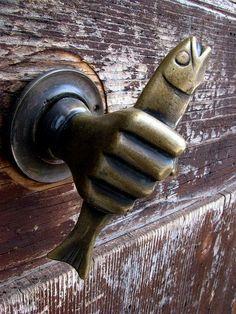 Antique Door Knocker I've got a fish in my hand now let me in.