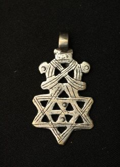 CROSS PENDANTS Ethiopia. One in the form of a Star of David. H 2in.-3in. Hand cast nickel-silver alloy.