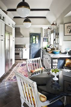 hicks pendants, with gray white black.  love the kitchen rug.  nice casual but luxe vibe