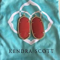 Red Kendra Scott Danielles EUC red Danielle earrings (the larger size). The last picture is one next to my bright red Dylan so you can see color comparison. No tarnishing, have been kept in dust bag. Only worn a handful of times. Selling because I bought some bright red ones! Will come with backs and dust bag. Price is firm but willing to trade for other Kendra. Cheaper on 〽️erc. Thanks for looking! Kendra Scott Jewelry Earrings