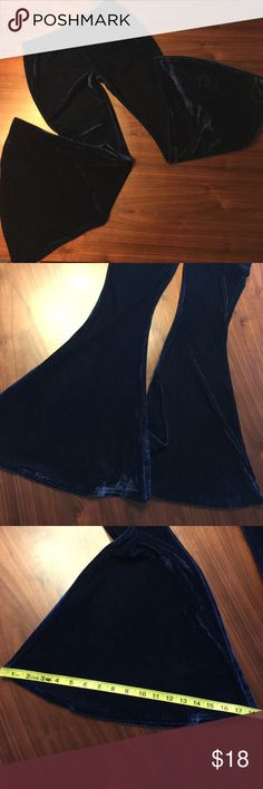 """Navy Blue Velvet Bell Bottoms Super Flares Sz M This is a brand new, never worn, wicked cool pair of navy blue velvet bell bottom leggings/pants in a size Medium. These elastic waist velvet bells are super soft and fit tight through the waist, hips and legs and open up to a massive 18"""" bell! These bells have a 29"""" inseam so would best fit someone petite in height. Measurements (taken flat and unstretched): waist 14.5"""", hips 17.5"""", rise 8.75"""", inseam 29"""", bell opening 18"""". Thanks for looking…"""