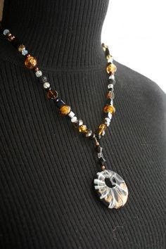 Black & copper round pendant on beaded necklace