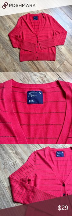 """NWOT American Eagle deep coral striped cardigan NWOT AEO deep coral red button down cardigan. Fun and feminine silver metallic thread stripes throughout. Armpit to armpit 20"""". Length from top of shoulder to hem approximately 24"""". 57% cotton / 34% nylon / 9% other fibers is super soft, smooth, and machine washable. Never worn or washed and still has the extra button attached to label/tag. American Eagle Outfitters Sweaters Cardigans"""
