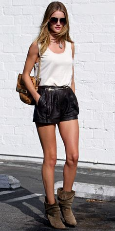 Huntington-Whiteley in a white tank and leather shorts, slouchy boots, a chain-strap Mulberry bag and Burberry aviators.