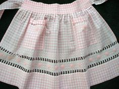 The first sewing project in junior high - a pink gingham apron.  This is not it - I was not an advanced seamstress.