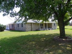 A 3 BR, 2 BA frame home with red brick, plus a 2-car attached garage on approx. 2 ACRES. Home is in a plated subdivision (Green Meadows Acres) on 2 lots outside of Green Forest city limits! The Assessor calls it 2,028 sq.ft. heated and cooled with 576' additional for the double garage, has a living room plus a large den or rec. room. The home has very good double pane, double hung windows. The floor in the kitchen is tile laminate, the counter tops are rolled Formica in Green Forest AR