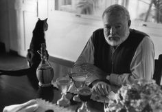 Torre Johnson  In the Hemingway house the cats roam everywhere, even monopolise the dining table.    These photos were taken in 1954 prior to Ernest HEMINGWAY's visit to Sweden to collect the Nobel Prize for Literature (1954) and show him and his wife Mary Welsh at their home in Cuba. It is called LA FINCA VIGIA (Lookout Farm) and is located in San Francisco de Paula in Cuba amongst thirteen acres of land and gardens, and an orchard, an oasis in the decaying Cuban town.