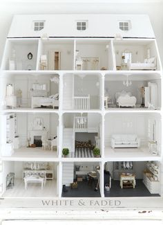 White & Faded dolls house