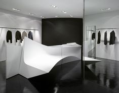 Neil Barrett Shop in Shop by Zaha Hadid Architects. Zaha Hadid Architects has completed five new boutiques for Milan-based fashion designer Neil Barrett, with each one containing portions of an abstract volume that was designed in one piece