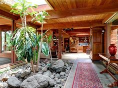 Remarkable Frank Lloyd Wright inspired home situated on 1+ acres on Willamette river frontage. New deck, sweeping views of expansive lawn, river, and private dock. Extensive use of cedar interior walls & ceilings. Classic mid-century solarium & rock garden greet you upon entering. Open floor plan and walls of glass. Quiet country setting. One level living! Office/library plus den or third bedroom, large eat-in  kitchen with huge skylights.