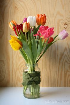 colorful tulips in a jar wrapped with lace trim band - spring is in da house!
