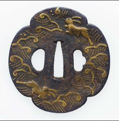 Tsuba with design of hares and waves. Japanese. Edo period. mid-late 17th century Heianjo School