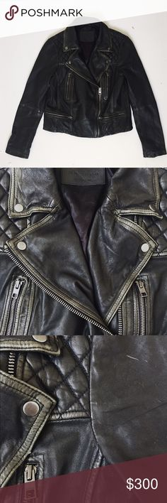 All Saints Cargo Leather Biker Jacket Allsaints women's leather cargo biker jacket in black/grey (color is closer to 2nd and 3rd photos taken in more direct lighting). One of Allsaints' bestsellers. Beautiful supple distressed leather, a few scratches to leather overall so it is priced for wear. Fit says UK 14 or US 10.  Product link here for more pics of the style: https://www.us.allsaints.com/women/leather/allsaints-cargo-leather-biker-jacket/?colour=140&category=25. All Saints Jackets…