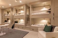 Cottage Guest Bedroom with High ceiling, Built-in bookshelf, Hardwood floors, Wall sconce, flush light, Carpet