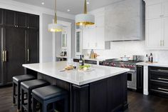 White and brown kitchen features white upper cabinets and espresso stained lower cabinets adorned with long brass pulls paired with white quartz countertops and a white iridescent tile backsplash. Stained Kitchen Cabinets, Espresso Kitchen Cabinets, Quartz Kitchen Countertops, Brown Cabinets, Upper Cabinets, White Countertops, Brown Kitchens, Home Kitchens, New Kitchen