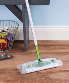 Put a sheet of wax paper on your Swiffer to get dust off the floor.