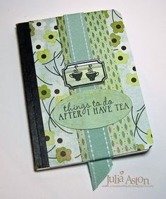 Composition book Journal with ribbon tucked underneath the paper cover so it can be used as a bookmark.  from Create with Julia