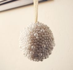 Handmade bauble, polystyrene ball, beads and ribbon.