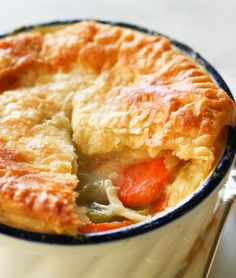 Chicken Pot Pie ~ Classic chicken pot pie recipe from Marshall Field's.  Chicken, celery, onion, carrots, peas, parsley, and thyme baked in a large ramekin lined and topped with pie crust. ~ SimplyRecipes.com
