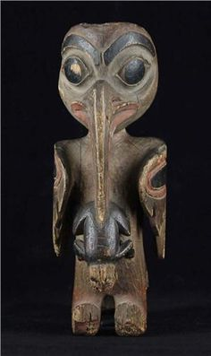 Northwest Coast carving - probably mosquito/frog figures.