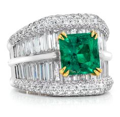 Cellini Jewelers Emerald & Diamond Ring Emerald-cut emerald, in a diamond mounting with a double row of diamond baguettes, edged with brilliant diamond pavé, set in platinum and 18-karat yellow gold. Emerald weight: 2.75 carats; Diamond weight: approximately 4.76 carats total.