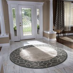 Round Area Rug In A Foyer.