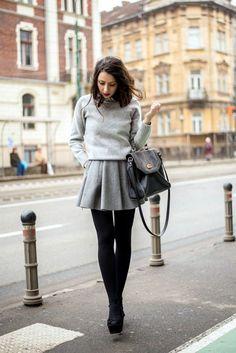 Tonal Chic: Grey Sweater, Grey Skater Skirt, Black Tights, and Black Booties & Bag