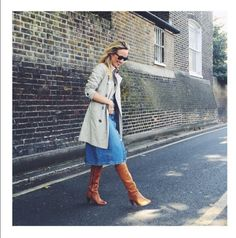 A Whistles denim midi skirt, a classic Burberry trench and tan knee-high's - all in a days style for our very fabulous editor.