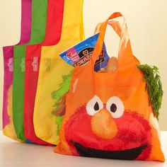Kids can help carry the groceries! Sesame Street market bags.