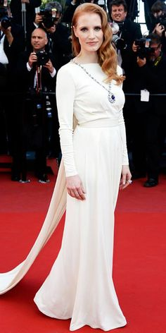 Jessica Chastain in a long-sleeved white gown and a sapphire Bulgari necklace
