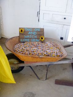 """Take one and watch love grow"" sunflower seeds for wedding favors in wheelbarrow"