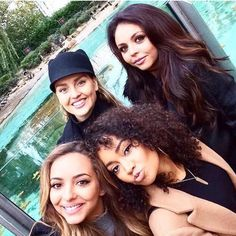Little Mix at the zoo. Their matte, nude makeup is very on trend.