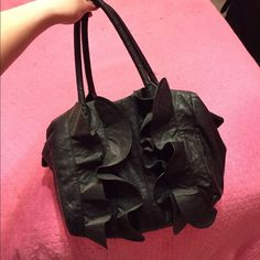 Black Ruffle Purse Great size, barely used. Pleather ruffle front. Great for holiday parties. Daisy Fuentes Bags Shoulder Bags