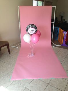 how to hang seamless photography background paper for fantastic photos - without spending a bunch of money on an expensive backdrop stand