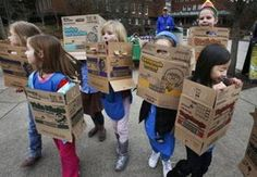 In a Feb. 18, 2013 file photo dressed in boxes emptied from earlier cookie sales, Girl Scouts from Troop 20337 in Eugene fan out on the University of Oregon campus near the Erb Memorial Union in Eugene, Ore., in search of customers for their cookies.