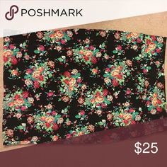 Brand new w/out tags LulaRoe Cassie (pencil skirt) Pretty floral print Cassie with black background size Large. I love this skirt, I just don't reach for it. It has almost a waffle knit, but stretchy material. LuLaRoe Skirts Pencil