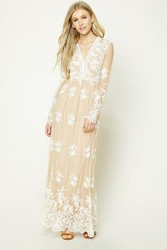 A mesh maxi dress featuring allover floral and baroque inspired embroidery, a V-neckline with a caged cutout trim, a caged cutout waistline, sheer long sleeves, scalloped trim, back slit on the lining, and an invisible back zipper.