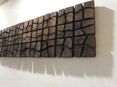 """This handmade wood wall art is made from Lithuanian Pine wood pieces! This Wooden Artwork measures 40"""" x 12"""" x 2""""! It weights about 10lbs (5kg)! Each wooden piece is individually aged and deep burnt, so it has deep structure and very old look! This Wood wall art can be custom painted to match your home decor! You can find our color palette which includes 18 colors in this listing: https://www.etsy.com/listing/214378773. This Wood wall art can be hung in vertical and horizontal position.."""