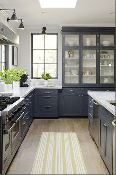 slate blue cabinets.