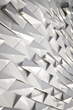 Facade to Titanic exhibit in Belfast / CivicArts & Todd Architects. This facade is very in/appropriate given the subject. Facade Architecture, Amazing Architecture, Architecture Geometric, Facade Design, Wall Design, Architectural Pattern, Building Facade, Interior Exterior, Belfast